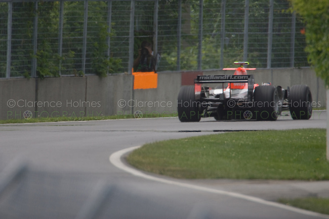 MONTREAL - JUNE 23: Test driver Giorgio Mondini of Midland F1 disappears from view after leaving the Senna complex during the second practice session on the Friday prior to race weekend of the Canadian F1 Grand Prix at the Circuit Gilles-Villeneuve June 23, 2006 in Montreal, Canada.