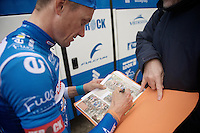 James Vanlandschoot (BEL/Wanty-Groupe Gobert) signing some newspaper snippets before the start<br /> <br /> 3 Days of De Panne 2015