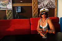 TURKEY Istanbul, woman with captain hat drinks Efes beer in Pub under bridge over Golden Horn/ TUERKEI Istanbul, Frau mit Kapitaens Muetze trinkt Efes Bier