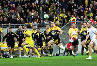 Fans and the Hurricanes bench react as Jason Woodward loses a pass during the Super Rugby match between the Hurricanes and Chiefs at Westpac Stadium, Wellington, New Zealand on Saturday, 23 April 2016. Photo: Peter Bush / lintottphoto.co.nz