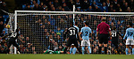 Angelo Ogbonna of West Ham United (r) opens the scoring with a header past Ederson of Manchester City during the premier league match at the Etihad Stadium, Manchester. Picture date 3rd December 2017. Picture credit should read: Andrew Yates/Sportimage