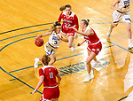 BROOKINGS, SD - FEBRUARY 22: Lindsey Theuninck #3 of the South Dakota State Jackrabbits drives the lane against Hannah Sjerven #34 of the South Dakota Coyotes Saturday at Frost Arena in Brookings, SD. (Photo by Dave Eggen/Inertia)