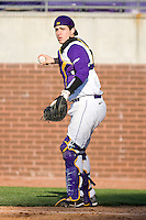 Catcher Jared Avchen #22 of the East Carolina Pirates on defense versus the Virginia Cavaliers at Clark-LeClair Stadium on February 19, 2010 in Greenville, North Carolina.   Photo by Brian Westerholt / Four Seam Images