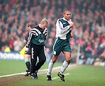 Stan Collymore of Liverpool is substituted and shows his club crest to the fans of his former club Nottingham Forest Premier League - Nottingham Forest v Liverpool - City Ground - Nottingham - England - 23rd March 1996 - Picture Simon Bellis/Sportimage