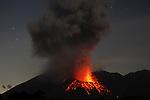 Explosion of Sakurajima volcano at night.