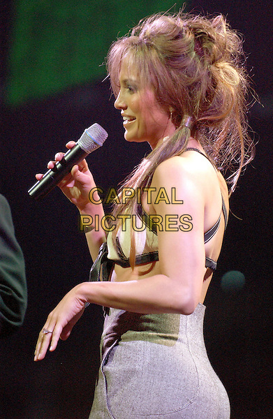 JENNIFER LOPEZ.performs at the102.7 KIIS-FM's 3rd Annual Jingle Ball held at The Staples Center in Los Angeles, California .05 December 2003.live, music, stage, concert, gig, j-lo, j lo, bad hair day, bunches, singing.www.capitalpictures.com.sales@capitalpictures.com.©Capital Pictures.