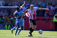 Danny Wright of Cheltenham gets away from Yvan Erichot of Leyton Orient during the Sky Bet League 2 match between Cheltenham Town and Leyton Orient at the LCI Rail Stadium, Cheltenham, England on 6 August 2016. Photo by Mark  Hawkins / PRiME Media Images.