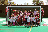 "11 March 2006: Jessica Zutz, Elizabeth Thompson, Caroline Hussey Bailey Richardson, Madison Bell, and Jordan Steele participate with kids in ""Learn about Field Hockey"" Day at the Varsity Turf Field at Stanford, CA. Proceeds benefited Duveneck Elementary School."