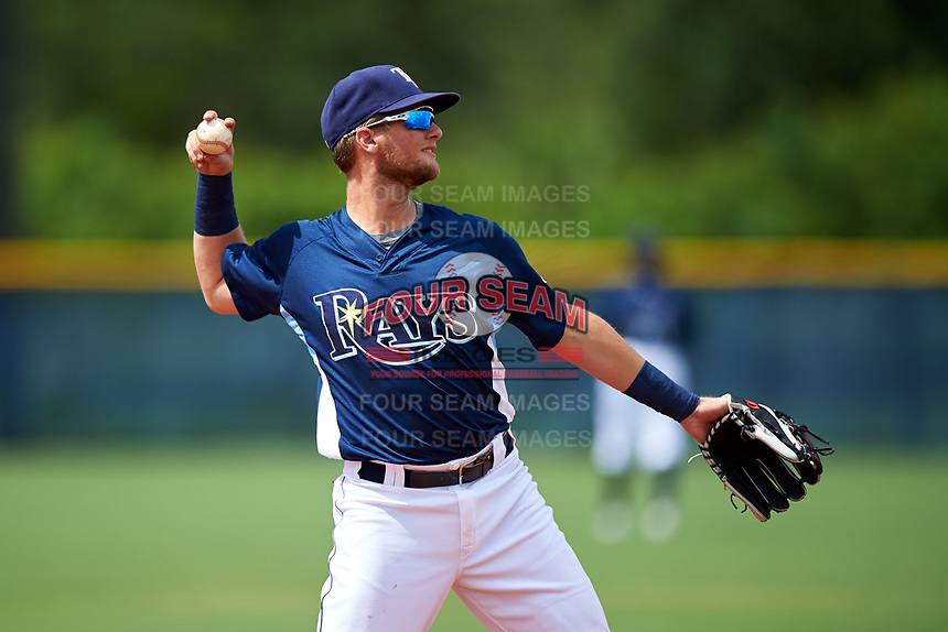 GCL Rays third baseman Allen Smoot (3) throws to first base during the first game of a doubleheader against the GCL Twins on July 18, 2017 at Charlotte Sports Park in Port Charlotte, Florida.  GCL Twins defeated the GCL Rays 11-5 in a continuation of a game that was suspended on July 17th at CenturyLink Sports Complex in Fort Myers, Florida due to inclement weather.  (Mike Janes/Four Seam Images)