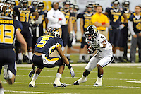 26 December 2010:  FIU wide receiver Wayne Times (5) attempts to evade Toledo safety Diauntae Morrow (5) after a reception in the second half as the FIU Golden Panthers defeated the University of Toledo Rockets, 34-32, to win the 2010 Little Caesars Pizza Bowl at Ford Field in Detroit, Michigan.