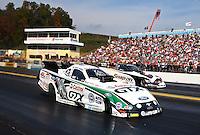 Oct 6, 2013; Mohnton, PA, USA; NHRA funny car driver John Force (near) defeats Cruz Pedregon during the Auto Plus Nationals at Maple Grove Raceway. Mandatory Credit: Mark J. Rebilas-