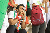 SARANSK, RUSSIA - June 25, 2018: An Iran fan react to tying their game against Portugal and being knocked out from a chance to advance during a 2018 FIFA World Cup group stage match at Mordovia Arena.