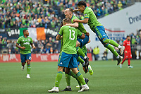 SEATTLE, WA - NOVEMBER 10: Seattle Sounders forward Jordan Morris #13, defender Brad Smith #11 and forward Raul Ruidiaz #9 celebrate after defender Kelvin Leerdam #18 scored a goal during a game between Toronto FC and Seattle Sounders FC at CenturyLink Field on November 10, 2019 in Seattle, Washington.