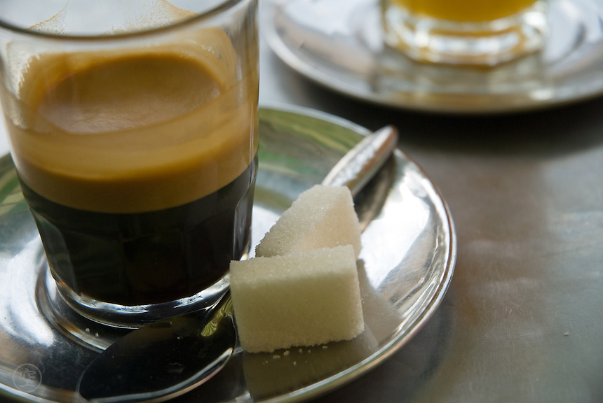 Moroccan coffee is served hot, strong, and black, with plenty of sugar at a cafe in Fes, Morocco.
