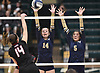Shannon Carey #14 of Bayport-Blue Point, center, and teammate Cathleen Farrell #5 defend against a spike attempt by Jamie Ryan #14 of Wheatley during the girls volleyball Class B Long Island Championship at Farmingdale State College on Sunday, Nov. 11, 2018.