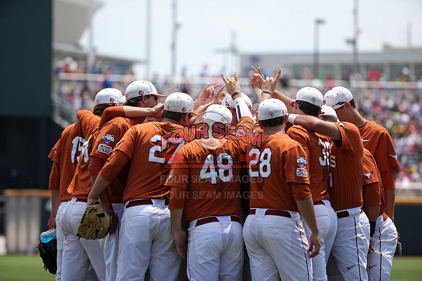 Members of the Texas Longhorns huddle prior to Game 1 of the 2014 Men's College World Series between the UC Irvine Anteaters and Texas Longhorns at TD Ameritrade Park on June 14, 2014 in Omaha, Nebraska. (Brace Hemmelgarn/Four Seam Images)