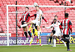 John Lundstram of Sheffield Utd in action with Jon Guthrie of Walsall during the Carabao Cup round One match at Bramall Lane Stadium, Sheffield. Picture date 9th August 2017. Picture credit should read: Jamie Tyerman/Sportimage
