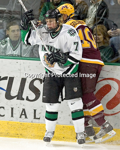 T.J. Oshie, Alex Goligoski - The University of Minnesota Golden Gophers defeated the University of North Dakota Fighting Sioux 4-3 on Saturday, December 10, 2005 completing a weekend sweep of the Fighting Sioux at the Ralph Engelstad Arena in Grand Forks, North Dakota.