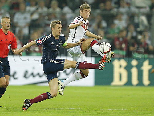 07.09.2014. Dortmund, Germany.   international match Germany Scotland  in Signal Iduna Park in Dortmund. Toni KROOS, skips away from the challenge of Darren FLETCHER, SCO