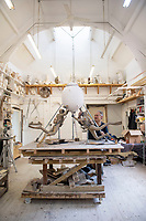 BNPS.co.uk (01202 558833)<br /> Pic: PhilYeomans/BNPS<br /> <br /> The fine art of surfacing -  Artist Mark Richards has gone to extraordinary lengths to create a lifelike 'floating' sculpture in tribute to Royal Navy mine and bomb clearance divers to be installed at Gunwharf Quays in Portsmouth next year.<br /> <br /> In an attempt to replicate the feeling of being submerged Mark suspended himself with ropes and pulleys, photographed a Navy drysuit in a local swimming pool, and reproduced in minute detail all the equipment used by brave service personnel in their perilous work.<br /> <br /> The completed sculpture will now be scaled up to 1.25 life size and cast in bronze at Morris Singer foundry in Hampshire.