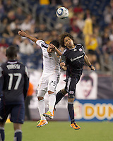 Los Angeles Galaxy forward Miguel Lopez (25) and New England Revolution defender Kevin Alston (30) battle for head ball. In a Major League Soccer (MLS) match, the Los Angeles Galaxy defeated the New England Revolution, 1-0, at Gillette Stadium on May 28, 2011.