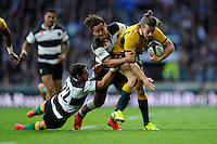Rob Horne of Australia is tackled by Tim Nanai-Williams and Joaquin Tuculet of Barbarians during the Killik Cup match between Barbarians and Australia at Twickenham Stadium on Saturday 1st November 2014 (Photo by Rob Munro)