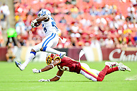 Landover, MD - September 16, 2018: Washington Redskins defensive back Montae Nicholson (35) tackles Indianapolis Colts running back Marlon Mack (25) during game between the Indianapolis Colts and the Washington Redskins at FedEx Field in Landover, MD. The Colts defeated the Redskins 21-9.(Photo by Phillip Peters/Media Images International)