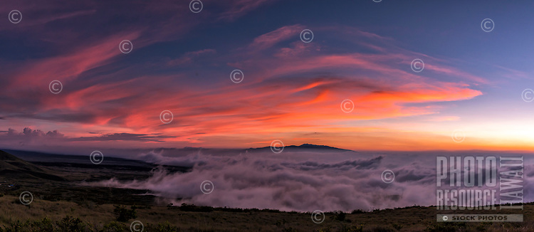 An upcountry sunset with Hualalai sandwiched between the clouds, seen from Kamuela (a.k.a. Waimea), Big Island.