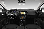 Stock photo of straight dashboard view of a 2017 Jeep Compass Limited 5 Door SUV