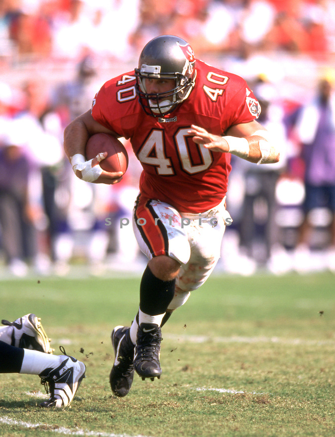Tampa Bay Buccaneers  Mike Alstott (40) during a game against the Minnesota Vikings on season November 1, 1998 at Raymond James Stadium in Tampa,  Florida.  The Tampa Bay Buccaneers beat the Minnesota Vikings. 27-24. Mike Alstott played for 11 years, all with the Tampa Bay Buccaneers and was a 6-time Pro Bowler.(SportPics)