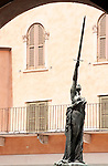 Monumento alle Vittime del 1915; a statue of a woman holding a sword up towards the sky in Verona, Italy that commemorates victims from World War One. Statue in Verona, Italy of a woman holding up a sword.