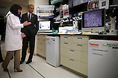 United States President Barack Obama (R) listens to Chief of the Biodefense Research Section Nancy Sullivan (L) as he tours the Vaccine Research Center at the National Institutes of Health December 2, 2014 in Bethesda, Maryland. President Obama visited the facility to discuss the ongoing fight against Ebola. <br /> Credit: Alex Wong / Pool via CNP