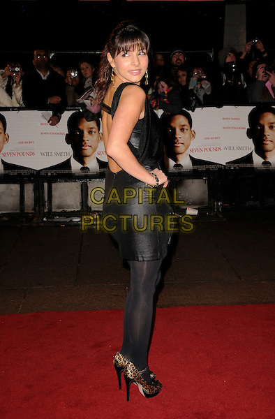 """ROXANNE PALLETT .Attending the UK Film Premiere of """"Seven Pounds"""" at the Empire Cinema, Leicester Square, London, England, January 14th 2009..full length black dress shiny tights leopard print shoes peep toe mary janes hand on hip looking back over shoulder rear behind .CAP/CAS.©Bob Cass/Capital Pictures"""