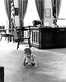 File photo taken on May 25, 1962 of John F. Kennedy, Jr. at play in the Oval Office in the White House in Washington, D.C.<br /> Credit: White House via CNP