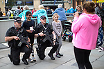 © Joel Goodman - 07973 332324 . 28/05/2017 . Manchester , UK . Two children pose for a photo with armed police , who are watching over the run . The Great Manchester Run 2017 . Security is still heightened in Manchester following a murderous bomb attack at an Ariana Grande gig at Manchester Arena on Monday 22nd May . Photo credit : Joel Goodman