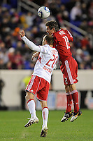 Joel Lindpere (20) of the New York Red Bulls and Logan Pause (12) of the Chicago Fire go up for a header during the first half of a Major League Soccer match between the New York Red Bulls and the Chicago Fire at Red Bull Arena in Harrison, NJ, on March 27, 2010.