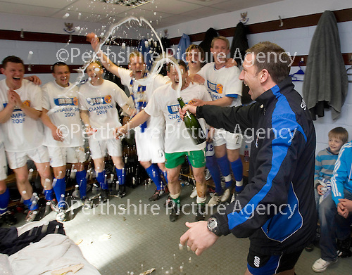 St Johnstone v Morton....02.05.09.Derek McInnes sprays champagne over his players in the dressing room.Picture by Graeme Hart..Copyright Perthshire Picture Agency.Tel: 01738 623350  Mobile: 07990 594431