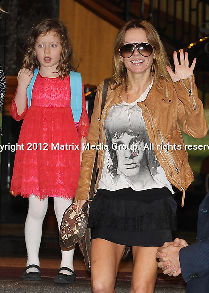 26 JUNE 2013 SYDNEY AUSTRALIA <br /> <br /> NON EXCLUSIVE <br /> <br /> Geri Halliwell Leaves The Sheraton On The Park Hotel with daughter Bluebell. <br /> <br /> <br /> *No internet without clearance*<br /> MUST CALL PRIOR TO USE .<br /> +61 2 9211-1088<br /> Matrix Media Group<br /> Note: All editorial images subject to the following: For editorial use only. Additional clearance required for commercial, wireless, internet or promotional use.Images may not be altered or modified. Matrix Media Group makes no representations or warranties regarding names, trademarks or logos appearing in the images.