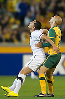 MELBOURNE, AUSTRALIA - MAY 24, 2010: Mark Bresciano of the Qantas Socceroos holds onto Leo Bertos of New Zealand at the FIFA World Cup farewell match between Australia and New Zealand at the Melbourne Cricket Ground, 24 May, 2010 in Melbourne, Australia. Photo by Sydney Low / www.syd-low.com