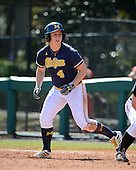 Michigan Wolverines Softball infielder Taylor Hasselbach (4) on first during a game against the Bethune-Cookman on February 9, 2014 at the USF Softball Stadium in Tampa, Florida.  Michigan defeated Bethune-Cookman 12-1.  (Copyright Mike Janes Photography)