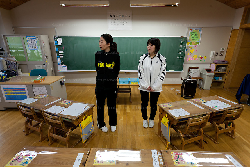 Teacher, Takako Kanazawa (left) and school nurse, Yui Agarashi (right) in  classroom of the first grade class at. Kawauchi Elementary School, Kawauchi, Fukushima, Japan. Tuesday April 30th 2013. Kawauchi was evacuated after the accidents at Fukushima Daichi nuclear plant but has been nominally decontaminated and some of the school children have returned to classes though the first grade has only seven students..