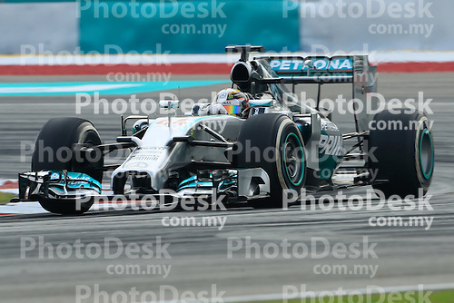 KUALA LUMPUR, MALAYSIA - MARCH 28: Mercedes driver Lewis Hamilton of Great Britain in action during the second practice session during the Malaysia Formula One Grand Prix at the Sepang Circuit on March 28, 2014 in Kuala Lumpur, Malaysia. (Photo by PETER LIM/PhotoDesk.com.my)