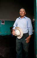 Francisco Hernandez, who is in charge of the field hands, stands outside the Tinacal where the pulque is left to ferment. Hacienda Xochuca, Pulque route, Tlaxcala, Mexico June 5, 2007