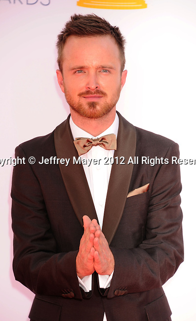 LOS ANGELES, CA - SEPTEMBER 23: Aaron Paul  arrives at the 64th Primetime Emmy Awards at Nokia Theatre L.A. Live on September 23, 2012 in Los Angeles, California.