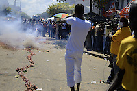 Visitors are watching to explosion of tens of meters long firecrackers in the city.....End of year 2010 celebrations on the streets of Paramaribo. Suriname is one of biggest consumer in South America that using firecrackers, fireworks ( also locally known as pagara ) for celebrations, especially for end of every years and also beginning of every new Chinese Years.