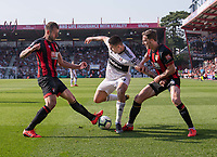 Fulham's Aleksandar Mitrovic (center) under pressure as he is tackled by Bournemouth's Steve Cook (left) and Dan Gosling (right) <br /> <br /> Photographer David Horton/CameraSport<br /> <br /> The Premier League - Bournemouth v Fulham - Saturday 20th April 2019 - Vitality Stadium - Bournemouth<br /> <br /> World Copyright © 2019 CameraSport. All rights reserved. 43 Linden Ave. Countesthorpe. Leicester. England. LE8 5PG - Tel: +44 (0) 116 277 4147 - admin@camerasport.com - www.camerasport.com