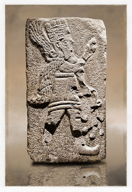 Picture & image of a Neo-Hittite orthostat with a releif sculpture of A Winged God from Aslantepe ,  Malatya, Turkey. Museum of Anatolian Civilisations, Ankara.  The God holds a branch of fruit in his left hand and a single fruit in the right hand. 5