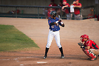 Missoula Osprey left fielder Jesus Munoz (23) at bat in front of catcher Griffin Barnes (28) during a Pioneer League game against the Orem Owlz at Ogren Park Allegiance Field on August 19, 2018 in Missoula, Montana. The Missoula Osprey defeated the Orem Owlz by a score of 8-0. (Zachary Lucy/Four Seam Images)