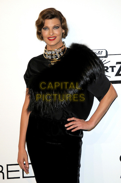 LINDA EVANGELISTA.The amfAR Gala at La Permanente during the Mailand Fashion Week Spring/Summer 2010 - Milan, Italy. .September 28th, 2009.half length black dress hand on hip gold diamond collar choker necklace feather fur cape collar wrap.CAP/RD.©Richard Dean/Capital Pictures.