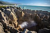 NEW ZEALAND, Punakaiki, Blow Hole Spits Water at Pancake Rocks, Ben M Thomas
